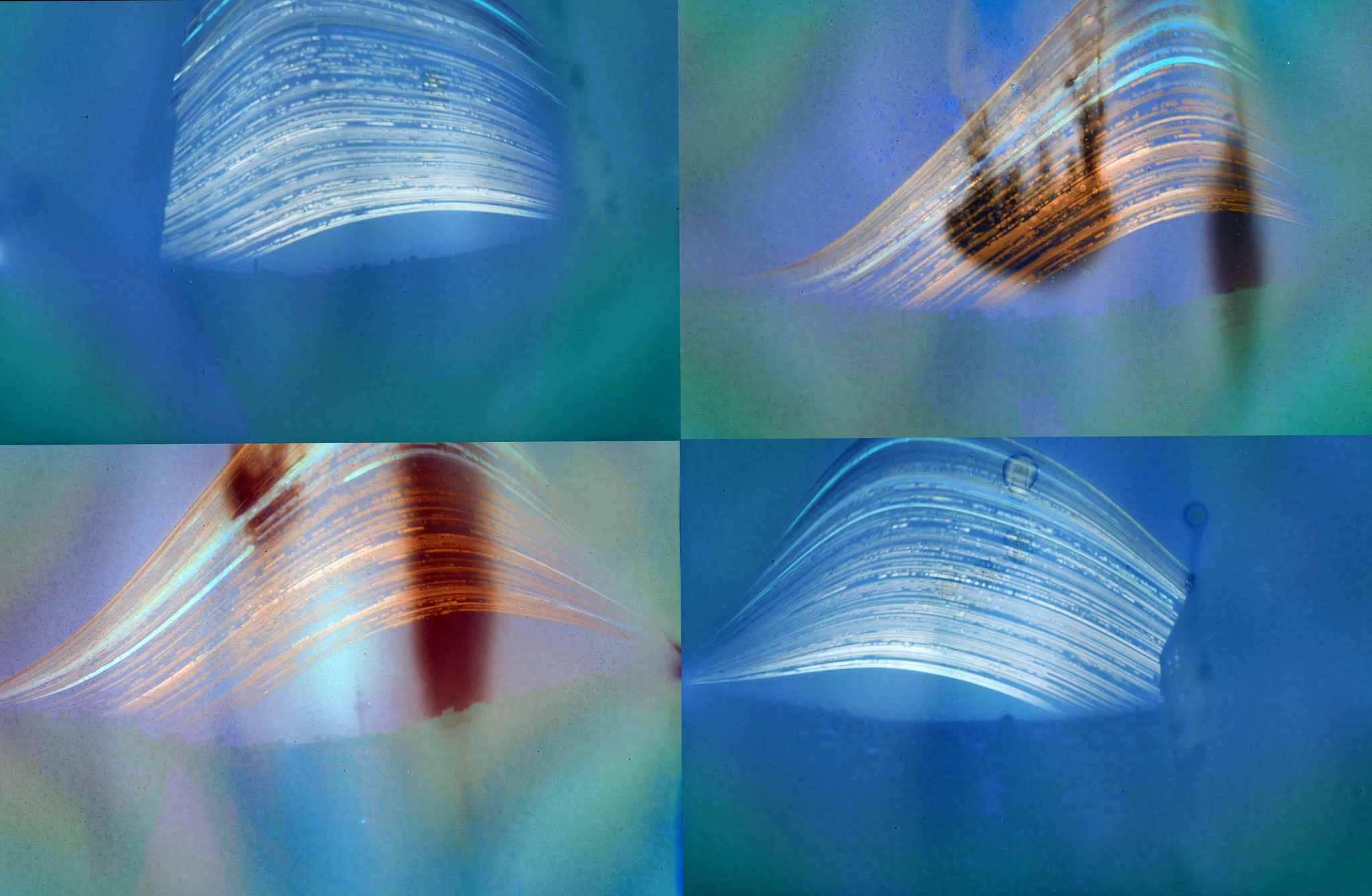 Pinhole images of a 6 month duration. Exposed on paper placed in beer cans which were installed on roofs facing South towards Grenfell Tower. The arcs of light are a record of the sun as it passes through the sky each day.
